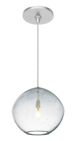 """LBL Lighting - Traditional Mini Isla Clear 7"""" Wide Satin Nickel Pendant - The Mini Isla mini pendant light features hand-blown art glass in an irregular round shape. It's crafted using an organic seeded technique for extra visual flair. The glass is illuminated by a brilliant xenon fixture. The satin nickel finished Fusion Jack mounts to a standard 4"""" electrical box and includes a built-in 12V 75W electronic transformer which fits neatly into the junction box. Hand-blown seeded art glass. Satin nickel finish hardware. Includes one 35 watt xenon bulb. Includes 8 feet of field-cuttable suspension cable. Female Fusion Jack port installed. 6"""" high. 7"""" wide.  Hand-blown seeded art glass.  Satin nickel finish hardware.  From LBL Lighting.  Includes one 35 watt xenon bulb.  Includes 8 feet of field-cuttable suspension cable.  Female Fusion Jack port installed.  6"""" high.  7"""" wide."""