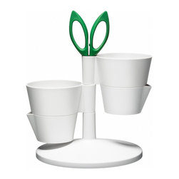 Normann Copenhagen Herb Stand - This funky little Danish caddy provides a spot to keep four different herbs growing indoors as well as the scissors for clipping them.