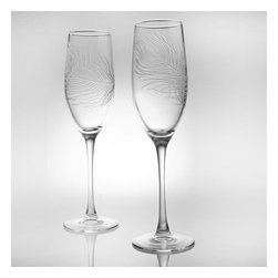 Rolf - Peacock Etched Toasting Flutes - The sophisticated art of a unique etched peacock feather elegantly gracing this lovely stemware is a delightful not to individuality and the unique spirit inside all of us. Your first sip of effervescent champagne will be a lasting memory with this exquisite set of 4 toasting flutes, and the delicate beauty of the peacock feather adorning the glass will create a majestic moment of your own. * Set of 4 * Capacity: 8 oz.