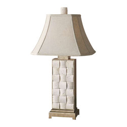Uttermost Travertine Table Lamp - Hand carved travertine stone inserts surrounded by antiqued silver metal with champagne highlights. Hand carved travertine stone surrounded by antiqued silver metal with champagne highlights. The rectangle bell shade is an oatmeal linen fabric with natural slubbing and clipped corners.