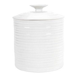 Sophie Conran White Canister - Store your dry goods in style with the Sophie Conran White Canister. This durable porcelain container is incredibly versatile and can hold an assortment of different things. Use it to store flour, sugar or even dog treats! It's microwave- and dishwasher-safe.About PortmeirionStrikingly beautiful, eminently practical, refreshingly affordable. These are the enduring values bequeathed to Portmeirion by its legendary co-founder and designer, Susan Williams-Ellis. Her father, architect Sir Clough Williams-Ellis, was the designer of Portmeirion, the North Wales village whose fanciful architecture has drawn tourists and artists from around the world (including the creators of the classic 1960s TV show The Prisoner). Inspired by her fine arts training and creation of ceramic gifts for the village's gift shop, Susan Williams-Ellis (along with her husband Euan Cooper-Willis) founded Portmeirion Pottery in 1960. After 50+ years of innovation, the Portmeirion Group is not only an icon of British design, but also a testament to the extraordinarily creative life of Susan Williams-Ellis.The style of Portmeirion dinnerware and serveware is marked by a passion for both pottery manufacturing and trend-setting design. Beautiful, tactile, nature-inspired patterns are a defining quality of Portmeirion housewares, from its world-renowned botanical designs modeled on antiquarian books to the breezy, natural colors of its porcelain and earthenware. Today, the Portmeirion Group's design legacy continues to evolve, through iconic brands such as Spode, the Pomona Classics collection, and the award-winning collaboration of Sophie Conran for Portmeirion. Sophie Conran for Portmeirion:Successful collaborations have provided design inspiration throughout Sophie Conran's life. Her father, designer Sir Terence Conran, and mother, food writer Caroline Conran, have been the pillars of her eclectic mix of cooking, writing, and interior design. In pairing with the iconic British housewares brand Portmeirion, Conran has created another successful collaboration: Sophie Conran for Portmeirion, an award-winning collection of dinnerware, serveware, and drinkware for the practical, multi-functional needs of contemporary kitchens.Launched in 2006, Sophie Conran for Portmeirion immediately received the Elle Deco Style Award for Best in Kitchens, and two years later, the House Beautiful Award for Best in Tableware. The soulful, tactile beauty of these oven-to-tableware pieces is exemplified by rippled surfaces and edges that evoke a potter's hand. This down-to-earth style is complemented by charming pastels, gentle earth tones, and classic whites and pinks, for a collection that will lighten and enliven contemporary kitchen decors. Though delicate to the eye and touch, these plates and bowls are built for durable performance, with microwave- and dishwasher-safe porcelain that's casual enough for breakfast and elegant enough for eye-catching dinners.