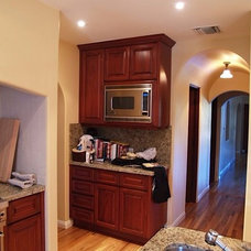 Modern Kitchen by Baron Construction & Remodeling Co.