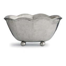 Cypress Medium Scalloped Planter - Hand-cast and hand-finished pewter was flawlessly worked by traditional artisans to produce this old-world Cypress Footed Bowl, which boasts a deep, commodious interior below a gracefully scalloped upper rim that smooths the features of your table. A smaller complement to the larger Cypress Bowl, it balances firmly on hefty ball feet for a look of distinction and substance, a feature which also keeps hot contents away from the surface of your table.
