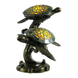 Beautiful Swimming Sea Turtles Stained Glass Lamp - This beautiful stained glass swimming sea turtles accent lamp adds the perfect accent to desks or nightstands of turtle lovers. Measuring 14 inches tall, 9 1/2 inches long and 10 inches wide, the lamp features an antiqued bronze finished cold cast resin base of the turtles` bodies and swirling water, with the shells made of marbled green stained glass. The lamp is brand new, never used or displayed. It uses nightlight style bulbs (included). It makes a great gift idea. We have a very limited supply of these, so don`t delay. Get yours now!