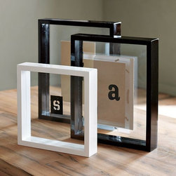 Floating Lacquer Frames - Your favorite photos float between two panes of clear glass.