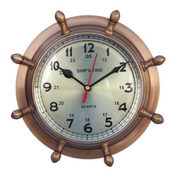 Handcrafted Nautical Decor - Antique Brass Double Dial Porthole Wheel Clock 8'' - The Hampton Nautical Double Dial Wheel Clock is a solid antique brass desk clock. This antique brand new ship wheel clock is a perfect accent to any home, office or study. This clock features both the 12-hour and 24-hour marks and has 1 minute interval marks. Inside the clock the words ''Ship's Time'' in an elegant font is displayed. The back features a groove to hang this clock on a wall.--This antique brass nautical clock, for desk or wall, can be engraved in the back or in the thin 2-inch outer layer. An engraved nameplate can also be placed on the back of the clock.--This nautical clock requires AA batteries to operate (not included).--------    Dual marked for 24-hour timekeeping--    Fully functional double dial wheel clock--    Antique brass      housing as opposed to plastic shell--    Battery operated requires AA batteries (not      included)--    --