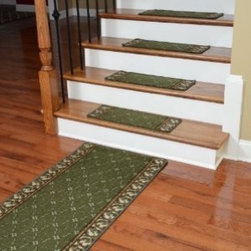 "Dean Flooring Company - Washable Non-Skid Carpet Stair Treads - Trellis Green (13) PLUS a 5' Runner - Washable Non-Skid Carpet Stair Treads - Trellis Green (13) PLUS a Matching 5' Runner : Washable non-skid carpet stair treads by Dean Flooring Company. Helps reduce slips on your hardwood stairs. Great for helping your dog easily navigate your slippery staircase. Polypropylene pile with a machine washable non-skid latex backing (wash on delicate in cold water, line dry). Also easy to spot clean or vacuum. Reduces noise. Reduces wear and tear on your hardwood stairs. Each set contains 13 pieces PLUS a matching 5' runner. Each tread is approximately 25"" x 9"". Easy DIY installation with double-sided carpet tape (not included). Adds an attractive fresh new look to your staircase."