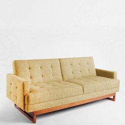 Either/Or Convertible Sofa, Yellow - This sofa's mustard color is subtle enough to outlast the summer, and I think it would be great for a breakfast nook. If I want to change the vibe of the kitchen, I'd just move it to another room — it's the perfect piece for apartment living.