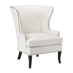"Chelsea Wing Chair - This classic wingback chair fits right into all kinds of styles, from traditional to contermporary. This is an especially handsome model; my favorite detail is the nailhead trim.Handcrafted by master furniture buildersFrame crafted of kiln-dried sustainably harvested hardwoodSeat cushions have high-resiliency foam cores with up to 10% soy-based materials, wrapped in pure feathers and downSolid maple legs stained ebonyNailhead trim in polished nickel or antiqued brass35""W x 35""D x 42""H; Seat: 22""H; Arm: 24""H"