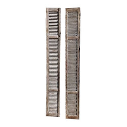 Tall French Shutters - Straight from Europe, these architectural gems have a great patina, and lots of detailing. Made of wood with iron hardware. They are a bluish gray with rustic wood.
