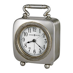 Howard Miller - Kegan Tabletop Clock w Antiqued Pewter Color - Antique, pewter-finished clock makes a statement on your favorite table top. Display it proudly in a guest room or any room. Square, carriage-style alarm clock is both practical and beautiful. A beaded frame encircles the dial for added interest. Illuminated dial is easy to see at night. This square, carriage-style alarm clock with handle features an antique pewter finish. A detailed beaded ���frame� encircles the dial. Round button feet add a charming detail. The dial is illuminated with a soft back light that creates a continuous ���glow� in the darkness. The dial light is powered by an AC adapter, which is included. The white dial offers black Arabic numerals and black hands, with silver second and alarm hands. Quartz movement with crescendo alarm includes the battery. Illuminated dial for viewing in a darkened room. 4 1/4 in. W x 2 in. D x 5 3/4 in. H