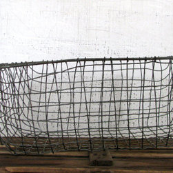 Extra Large Urban Farmhouse-style Wire Basket by Tribute 212 - A metal basket for corralling lose items around the house is always in style.