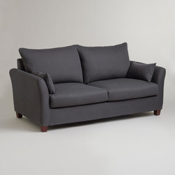 World Market - Charcoal Luxe Sofa Slipcover - Slip your Luxe Sofa into something a little more chic with our Charcoal Luxe Sofa Slipcover. It's designed to fit like a glove. Easy to clean and beautiful to look at, this stylish slipcover is a brilliant way to change the look of your living room affordably. Keep one slipcover on the sofa and one stored in your linen closet for a handy way to manage life's little spills.