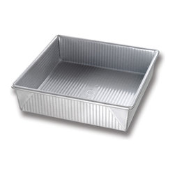 USA Pans 8 inch Square Cake Pan - The USA Pan 8 Inch Square Cake Pan has been designed with many of the same standard features of industrial baking pans.  Each pan is constructed of aluminized steel  the material of choice for commercial bakeries.  Metal thicknesses have been selected that allow even heat distribution and maximum service life.  Our pans also use steel wires in the rim construction of most pans to provide additional strength and resist warping.  Each pan is coated with AMERICOAT© Plus  a proprietary silicone coating that nearly all North American bakers prefer over dark non-stick coatings.   AMERICOAT© Plus is a clear non-stick  environmentally friendly coating that is specifically formulated for superior baking and does not contain any PTFE̥s or PFOḀs.  USA Pan bakeware features a corrugated  or fluted  design.  The corrugation maximizes pan strength and prevents warping  denting and other effects of everyday use.  Corrugation also minimizes surface contact with baked goods which translates into an evenly baked product that is easily released. USA Pan has been developed by the world's largest manufacturer of industrial bakeware and has been providing the world's leading commercial bakeries with the highest quality baking pans for over 50 years.  When you purchase a USA Pan you are buying products that meet industrial standards for innovation  quality and durability.  Put simply  our pans are the best available and are proudly produced in the UNITED STATES OF AMERICA. Product Features                                   Constructed of heavy gauge aluminized steel             Corrugated design allows for even baking            Proprietary AMERICOAT© coating allows easy release of food            Proudly made in the USA for over 50 years