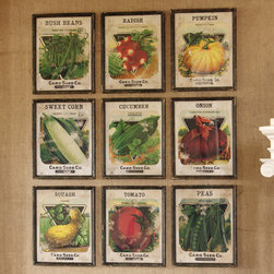 "Vintage Seed Pack Prints (Set of 9) - Our nostalgic and colorful seed packet prints showcase beautiful graphics in a nine piece collection perfect for gardeners or chefs alike. Encased in wood with glass frames, the charming rustic touches both on prints and frames make these an inspired selection for placement in garden rooms, covered porches or country kitchens. A home and garden collection selected that bring happy memories of childhood past. Whether you are looking for period charm, a style of elegant restraint or just want to infuse a spirit of playfulness, you'll find it here. Dimensions: 16""w x 20""h each"