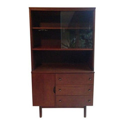 Pre-owned Danish Modern Mid-century China Cabinet - This beautiful Mid-Century cabinet makes for an excellent china storage or bookshelf. The cabinet is in great condition with only minor nicks and wear appropriate with age. Includes a cup hanger inside the glassed in shelving area. Drawers and glass are smooth and clean. It would make one fabulous bar!