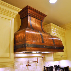 Art of Rain - Custom Copper Range Hood- Bettina Range Hood - The Bettina Copper Range Hood provides a unique vintage European style to your kitchen. This copper range hood comes with forged iron straps that wrap around the copper body. Bettina has a great patina finish that is easy to maintain and will last you for decades.