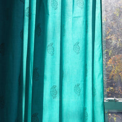 Curtain - This beautiful lightweight, semi translucent curtain, has been hand block printed with gold print that looks beautiful when held to the light. Perfect for filtering bright daylight or providing added privacy. Each curtain has hand ties at the top for easy installation on any curtain rod & a border design at the top.