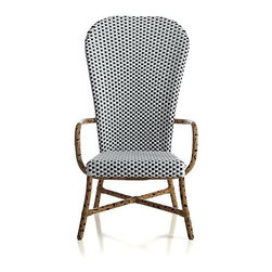 Fish High-Back Woven Armchair - This comfy and whimsical chair looks so versatile. I love the polka dot design, which would look fabulous indoors or out. I think it would be great as a wing chair at the head of a table.