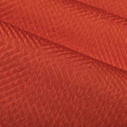 Impulse Geometric Upholstery Fabric in Brick - Impulse Geometric Upholstery Fabric in Brick has a rust hued diamond pattern with a slight sheen that gives a metallic look. Ideal for upholstering sofas, chairs, and ottomans or for creating custom bedding and pillows. Made in the USA from a blend of 18% cotton, 32% olefin, and 50% polyester. This upholstery fabric passes 30,000+ double rubs on the Wyzenbeek Abrasion Test. Passes CA117 Test, UFAC 1 Width 53″; Repeat: 5 3/4″ H; 5″V