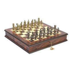 Hannibal Roman Metal Chess Set - Get historical and defend your chess empire with the Hannibal Roman Metal Chess Set. This new pairing pits the gorgeous all-metal Hannibal Roman chess pieces with one of our two best storage boards for a royal look you won't find anywhere else. Each piece is finished in silver or brass and stands up to 3 inches tall, perfect for playing on our Locking Chess Cabinet or Leatherette Cabinet Board. About the Leatherette Cabinet Board The Leatherette Cabinet Board offers a classic and handsome style, with unique design touches like decorative stitching and green and cream squares that make it truly distinctive. Leatherette construction offers the rich look and feel of leather, but makes the board much easier to clean and care for. The board opens to reveal a storage space fitted for a full set of pieces. Board size: 12.5L x 12.5W inches. Square size: 1 3/8 inches. Exquisite Locking Chess Cabinet The Exquisite Locking Chess Cabinet will beautifully complement your favorite chessmen. Crafted from the finest maple, walnut, mahogany, and briarwood, this unique design features distinctive chess-themed inlays and a rich brown and white contrasting finish. Brass piano hinges complete this elegant look. A storage compartment beneath keeps your pieces secure between games. This cabinet comes complete with lock and key. It was handmade for you in Italy. Square size: 1.38 inches. Board About Cambor GamesNew Jersey-based Cambor Games has spent the last 30 years developing product lines to address a variety of classic gaming needs. The company offers chess sets, backgammon boards, poker equipment, dominoes, mahjong tiles, and more. From traditional designs to novelty themed items, value-priced beginner sets to high-end collectors' dreams, Cambor Games has the game equipment you need to have years of fun with close friends or bitter rivals.