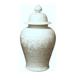 Belle & June - Crystal Shell Temple Jar Large - What secrets are hidden inside this mystical jar? Curvy and sweet with some structural flare, this snow-white accent piece is a stunning addition to your living room or office. Try placing it solo on the credenza, or use a pair on your fireplace mantel for a clean and airy look.