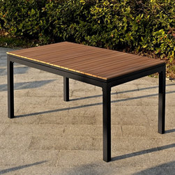 Belham Living - Belham Living Carmona Faux Wood Slat Extension Table - RY1093T - Shop for Tables from Hayneedle.com! Seat a large group or an even larger group with the Belham Living Carmona Faux Wood Slat Extension Table. This rectangular table has a sturdy aluminum frame in a classic black finish. It seats six around its slat-style faux wood top. Need to see a couple more? No problem. Simply pull the ends apart to reveal a self-storing table extension. Easily put the extension into place and you've got room for eight. This table is equipped with an umbrella hole when the extension leaf is in use. Enjoy the traditional touch the faux wood top brings with none of the traditional upkeep required of real wood. About Belham LivingBelham Living builds catalog-quality furniture in traditional styles at a price that actually makes sense. By listening to our customers and working closely with great manufacturers we build beautiful pieces worthy of your home. Rich wood finishes attention to detail and stylish lines that tie everything together are some of the hallmarks of a Belham Living piece. From the living room or bedroom through the kitchen and out onto the deck there's something from an incredible Belham collection perfect for your style.