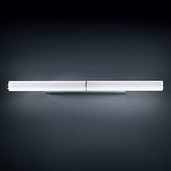 Norma Bath Bar  by Nemo Italianaluce - Norma bath bar features a tubular white pyrex glass shade with a chrome finish.  37 inch fluorescent version has one 39 watt, 120 volt, T5 lamp. 26 inch fluorescent version has one 24 watt, 120 volt, T5 lamp. 26 inch halogen version has three 75 watt, 120 volt, T3 lamps. 50 inch version requires four T3 short RSC 75 watt 120 volt halogen lamps and can be mounted horizontally only. Lamps not included. General light distribution. Made in Italy.