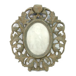 Carved Birch Picture Frame - A photo from a sojourn across the sea. A fondly remembered celebration. The visage of a loved one. All may be wonderfully presented in the Picture Frame. Crafted of birch wood, the frame features a pattern of intertwining leaves with a moss green finish that is gently distressed to reveal hints of ivory and rust. The center oval is accentuated with a simple raised rim that allows for the distinctive display of your photos or paper ephemera.