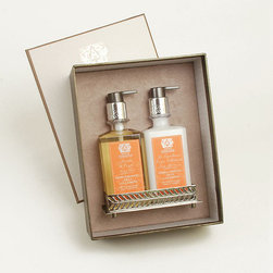 Frontgate - Antica Farmacista Orange Blossom Bath & Body Gift Set - Orange Blossom, Lilac, and Jasmine is a bright, captivating fragrance that begins with floral notes of orange blossom, lilac, and jasmine, which mingle with citrus notes of mandarin and lemon. A subtle hint of vanilla musk grounds the fragrance. Bath salts dissolve quickly while revitalizing and nourishing the body. Bubble bath is generously enriched with honey, aloe vera, green tea, and jojoba oil for a calming ambiance. Moisturizing soaps have a cream lather that's a wonderful treat in the shower or at the sink. Gift Set includes hand wash, body moisturizer, and tray. Enticingly aromatic and made of the finest ingredients, Antica Farmacista Spa Products will captivate you with their rejuvenating and therapeutic qualities. Each product is handsomely packaged for giving and displaying.  .  .  . Moisturizing soaps have a cream lather that's a wonderful treat in the shower or at the sink .  . Room sprays instantly refresh bed linens or any area of the house . Made in the USA.