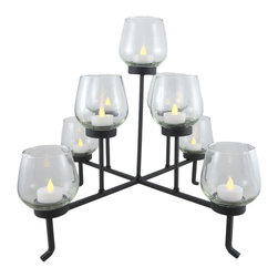 Zeckos - 9 Glass Votive Tea Light Candle Holders With Black Metal Stand - This candle holder set is the perfect centerpiece for your table in the dining room, the entryway or living room featuring 9 glass votive/tea light holders on a black metal wrought iron look stand. Measuring 15 inches high, 18 inches long and 18 inches wide (38 X 46 X 46 cm), it would also look amazing displayed in a non-working fireplace. It's sure to make a dramatic statement in any room, and is great as housewarming gift sure to be admired.