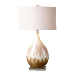 Uttermost Flavian Glazed Ceramic Lamp - Ceramic base finished in a metallic rust beige glaze with ivory undertones and crystal accents. Ceramic base finished in a metallic rust beige glaze with ivory undertones and crystal accents. The slightly tapered oval hardback shade is a light beige linen fabric with natural slubbing. Due to the nature of fired glazes on ceramic lamps, finishes will vary slightly.