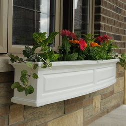 Mayne 60-Inch Nantucket Polyethylene Window Box - Additional FeaturesFeatures a durable double wall designFeatures built-in overflow drainsAvailable in your choice of colorsWith its gorgeous bowed front, raised panel design, and pronounced crown molding design, the only thing more beautiful than the Mayne 60-Inch Nantucket Polyethylene Window Box are the flowers it displays. Designed for practicality, this window box features built-in overflow drains and also has a sub-irrigation water system which encourages root growth. Crafted from durable and high-grade polyethylene, this window box also has a double wall design, and comes with four steel wall mount brackets with a black, powder coated finish and comes in your choice of color.