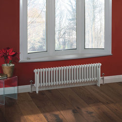 Hudson Reed - Traditional 26 x 2 Column Radiator Cast Iron Style White 11.8 x 46 - Hudson Reed Traditional 26 x 2 Column Radiator Cast Iron Style White 11.8 x 46This cast iron style radiator, with a high quality white powder coat finish (RAL 9016), has vertical double columns that give an outstanding heat output of 719 Watts (2,455 BTUs), enough to warm a room quickly and efficiently.Although the classic design of this steel radiator is an ideal complement to traditional settings, it fits in equally well with contemporary décor, especially when combined with a set of modern valves. This versatile radiator is compatible with all domestic central heating systems, will connect with your existing pipe work and is supplied complete with a wall mounting kit. For a truly authentic look, combine this traditional-style radiator with a Hudson Reed floor mounting kit (TRUSH017).Traditional 26 x 2 Column Radiator 11.8 x 46 Details  Dimensions: (H x W x D) 11.8 (300mm) x 46 (1170mm) x 2.7 (68mm) Projection When Fitted: 4.5 (115mm) Wall To Centre Of Tapping: 3.4 (85mm) Output: 719 Watts (2,455 BTUs) Material: Steel Finish: White Powder Coat (RAL 9016) Columns: 2 Wall Mounting Brackets Included Optional Floor Mounting Kit Available - See Essential Extras Below Please note: Angled Radiator Valves are required, please choose either modern or traditional radiator valves. 5 Year Guarantee on materials and finish  Please Note: Our radiators are designed for forced circulation closed loop systems only. They are not compatible with open loop, gravity hot water or steam systems.