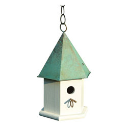 Heartwood - Copper Songbird Birdhouse opper Verdigris Roof - The  hexagonal  body  of  this  copper  songbird  home  is  sure  to  please  the  gardener  or  bird  lover  in  your  life.  Made  of  solid  cypress  and  equipped  with  a  six-sided  solid  copper  roof,  it  is  available  in  other  colors.  Hanging  loop  and  matching  copper  perch  help  to  complete  the  look,  with  easy  cleanout  and  optional  easy  mounting.          Product  Details:                  7x7x15              Available  in  verdigris  roof,  brown  roof  or  solid  mahogany  with  bright  copper  roof              Handcrafted  in  USA  from  renewable,  FSC  certified  wood