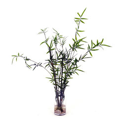 None - Bamboo Branches with River Rocks in Glass Vase - Bamboo stalks are arranged in a glass cylinder filled with river rocks for an exotic presentation. This faux arrangement stands 36 inches high.
