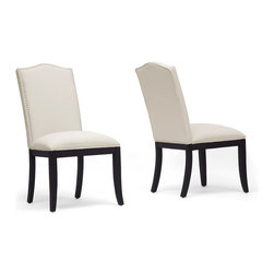 Baxton Studio - Baxton Studio Tyndall Beige Linen Modern Dining Chair (Set of 2) - Enhance the mood in your dining space with an element of simple regality. The Tyndall Designer Dining Chair is made in China with a wooden frame, foam cushioning, beige linen seating, and its trademark: a lovely silver upholstery tack border. Black wooden legs with non-marking feet complete this contemporary dining chair. Due to the absorbent nature of the seating, the chair must be spot cleaned. Assembly is required.