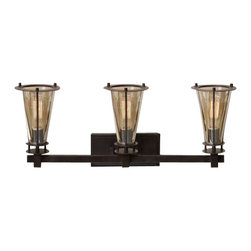 Uttermost Frisco 3 Light Rustic Vanity Strip - Plated cognac tinted glass accented with rustic black metal details. Plated cognac tinted glass accented with rustic black metal details. 40 watt antiqued style bulbs included.