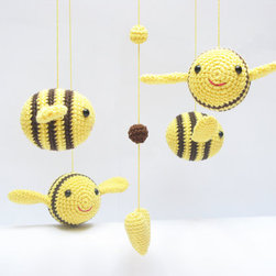Baby Nursery Amigurumi Crochet Bumble Bee Mobile by Cherry Time - Babies love contrasting colors, so this handmade bee mobile is sure to catch his or her eye. I wonder what newborns are thinking while they gaze at their mobiles.