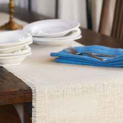 Origin Crafts - Bleached burlap table runner - Bleached Burlap Table Runner The Burlap tablecloth?s simplicity and utility make it a year round favorite. Its natural, jute fibers can be left unadorned for an understated glamour or dressed up with colorful accessories, such as our Kantha placemats or patterned napkins. A Caravan exclusive. Biodegradable and eco-friendly: made of 100% authentic jute fibers. Dry clean only. Dimensions (in):16x72 inches,16x90 inches By Couleur Nature - Couleur Nature is a wholesaler of fine, French-inspired Indian woodblock-printed and vintage linens. Couleur Nature?s linens and home accessories are versatile and can be used for formal or casual table settings year-round, as well as the every day. Their distinct but wide appeal makes them ideal for almost any occasion, decor or personal style. Usually ships in three business days. Our linens are handmade: slight variations are natural and make each piece unique.