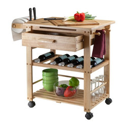 "Winsome Wood - Winsome Wood Finland Kitchen Cart with Natural Finish X-44638 - The ultimate kitchen cart, the Natural Finland cart provides bevy of storage options and a spacious workspace.  Hide utensils and cutlery in the deep drawer, keep wine bottle safe and sound on the rack, towels on each hooks, knife block keeps the knives safe then storage plates and glasses on the bottom shelf.  Durable casters allow you to easily move the cart.  This compact kitchen island is ideal for small kitchen that need more workspace.  Shelf is 21.1""W x 15.90""D.  Drawer inside dimension is 19.76""W x 13.58""D x 4.33""H.  Overall cart dimension is 35""W x 20.50""D x 31.50""H.  Construction from solid and composite wood in Natural finish.  Assembly Required."