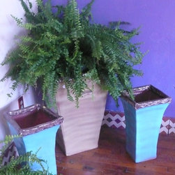 Ceramic Planter - Angular ceramic planters are slab-built by hand and glazed in rich colors.  They're versatile enough for a natural garden setting or a more formal indoor arrangement. photo by stewart gray
