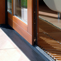Lift Slide Doors - Zola Lift-Slide doors offer great openings – with 20 feet maximum width made from just two large glass panels, Lift-Slide doors are a quintessential tool for modern living. No other type of patio door can offer expanses of glass this big without dividers limiting your view. Zola Sliding Doors are fantastically well insulated to ensure cozy comfort and energy efficiency in your home – with only glass in between you and your view. Our sliding doors offer the biggest expanses of moving glass anywhere. Our flagship product, the twenty feet wide and eight feet high lift-slide door, consists of only two ten feet wide moving glass panes. A simple turn of the handle gently lifts the entire door out of it seal, and it can then glide with the push of two fingers to the side.