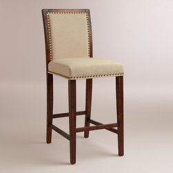 World Market - Linen Greyson Barstool, Set of 2 - Upholstered in creamy linen, our Linen Greyson Barstool looks as if it's been in the family for generations. Crafted of acacia wood with a textured finish, it's detailed with nail head accents for elevated elegance.