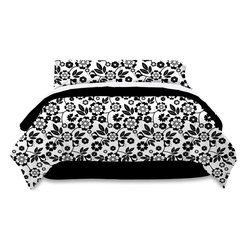 Pem America - Black and White Floral King Bed Ensemble - Bring a stark contrast into your room.  The pure white background hosts a large graphic floral design on the comforter face and pillow shams.  The reverse of the comforter and the bed skirt are midnight black. Includes king size comforter 90x100 inches, bed skirt, and two standard shams (20x26 inches). Includes king size sheet set with flat sheet, fitted sheet, and two pillowcases. 100% Microfiber polyester face and 100% polyester fill. Machine washable.