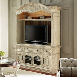 American Drew - Jessica McClintock-Boutique Collection Entertainment Center - White Veil - Conso - Shop for Visual Centers and Stands from Hayneedle.com! Take movie night from the usual to the unusually elegant with the Jessica McClintock-Boutique Collection Entertainment Center - White Veil - Console and Hutch. Crafted with durable solid wood and wood veneers that resist warping this traditional two-piece set includes a media console and hutch. The console centerpiece is outfitted with three drawers and four doors - two of them glass-paneled - that open to adjustable shelves. The hutch fits neatly atop the console with wide-open space for a TV up to 69W inches and an upper open storage shelf. Throughout intricate carved trim molding and lush details are highlighted by a heavily distressed white veil finish. Antique-inspired hardware completes the classic look.DimensionsConsole: 69W x 22D x 34H inchesHutch: 70W x 23D x 62H inchesAbout American DrewFounded in 1927 American Drew is a well-established leading manufacturer of medium- to upper-medium-priced bedroom dining room and occasional furniture. American Drew's product collections cover a broad variety of style categories including traditional transitional and contemporary. Their collections range from the legendary 18th-century traditional Cherry Grove celebrating its 42nd year of success to the extremely popular Bob Mackie Home Collection influenced by the world-renowned fashion designer Bob Mackie. Jessica McClintock Home features another beloved designer bringing unique style to an American Drew line. American Drew's headquarters are located in Greensboro N.C. Their products are distributed through thousands of independently owned retailers throughout the United States and Canada and around the world.