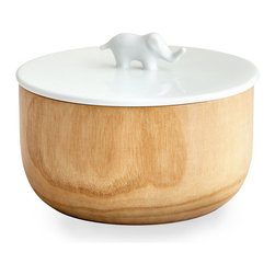Elephant Container - Whimsical, natural, and large enough to contain a number of small necessities, the Elephant Container is an opaque alternative to apothecary jars or an artistic variation on canisters � whether you place it on your coffee table or on your bathroom vanity.  The white ceramic lid is flat but for the sweet, simple elephant handle; the dish below is carved from natural wood for a warmer effect.