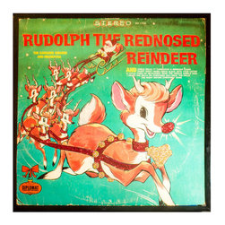 """Glittered Rudolph the Red Nosed Reindeer Album - Glittered record album. Album is framed in a black 12x12"""" square frame with front and back cover and clips holding the record in place on the back. Album covers are original vintage covers."""