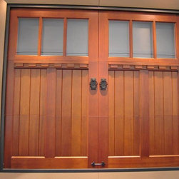 International Builders Show 2014 - Handcrafted Clopay Reserve Collection custom wood carriage house style garage door with rectangular windows and decorative dentil shelf molding. Opens overhead. Other design options, wood species, and stain finishes available.