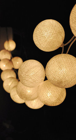 Handmade White Cotton Ball String Lights by Ginew - Light up the night with a string of pretty globes and cast a soft glow on your patio. There is just something so special about strings of lights overhead.